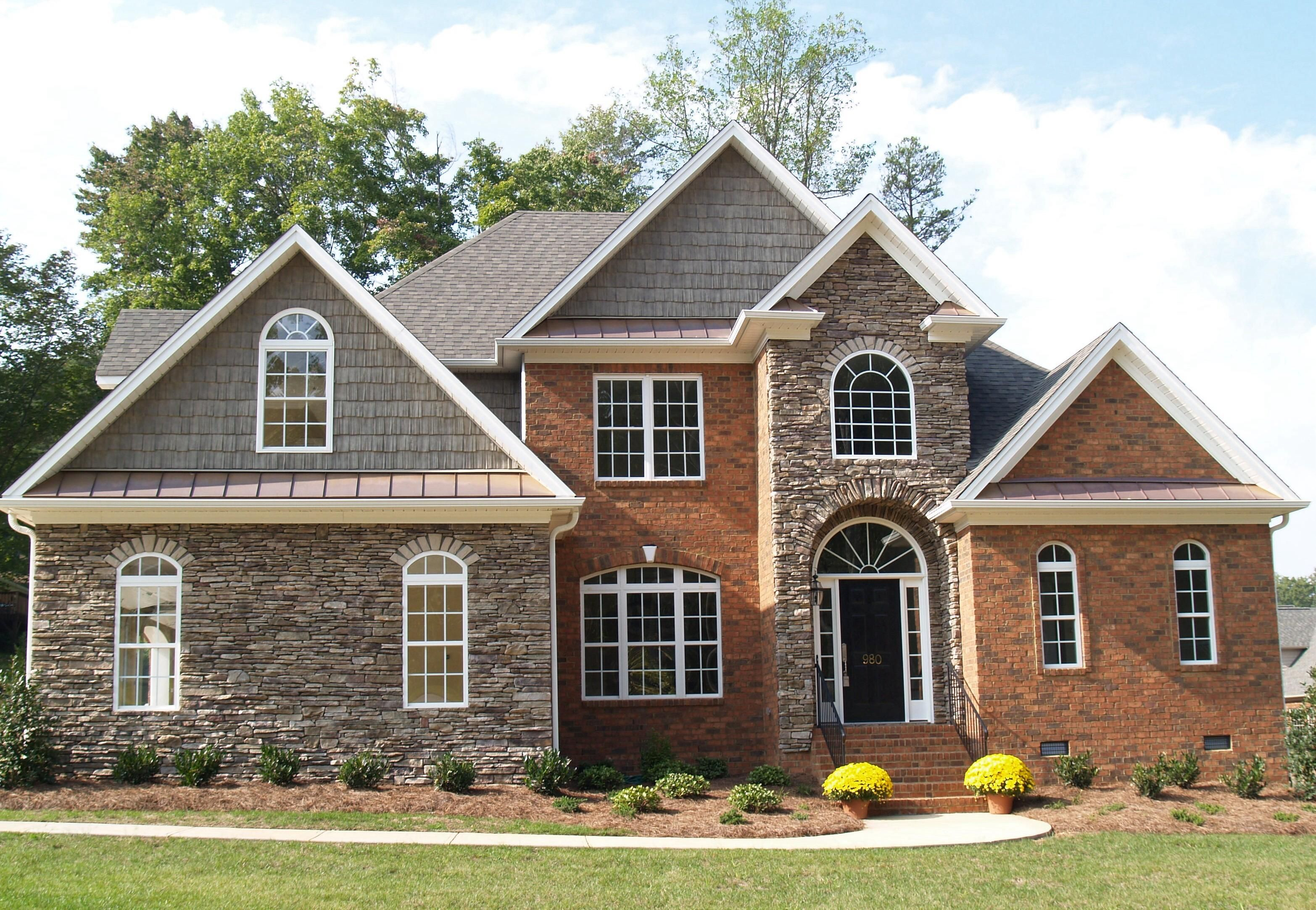 Accents for red brick homes mixed media using brick and Stone and wood house plans