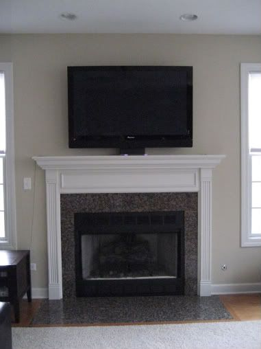 images of televison over fireplace