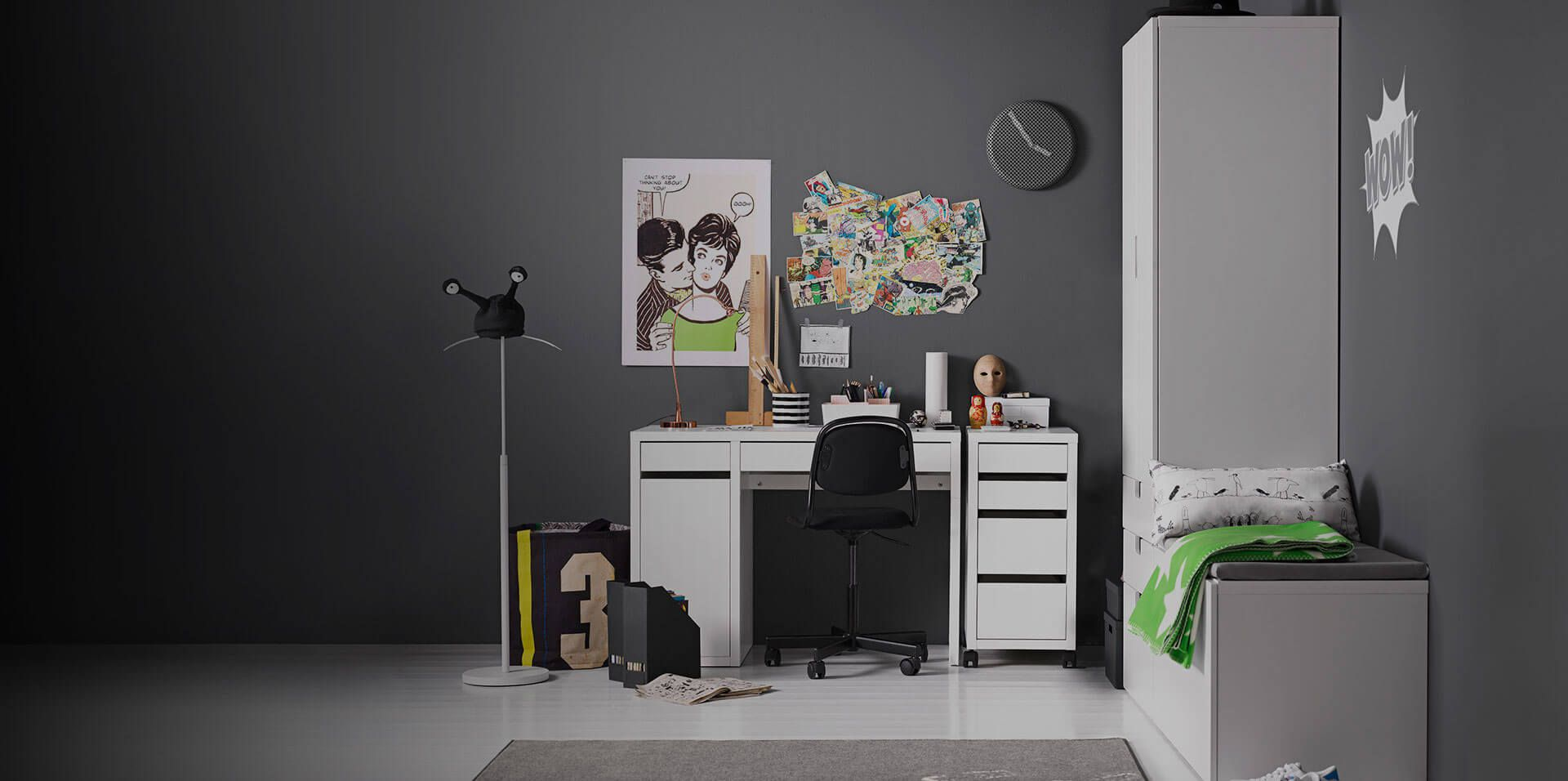 White Micke Desk In A College Dorm Room With Posters On The Wall