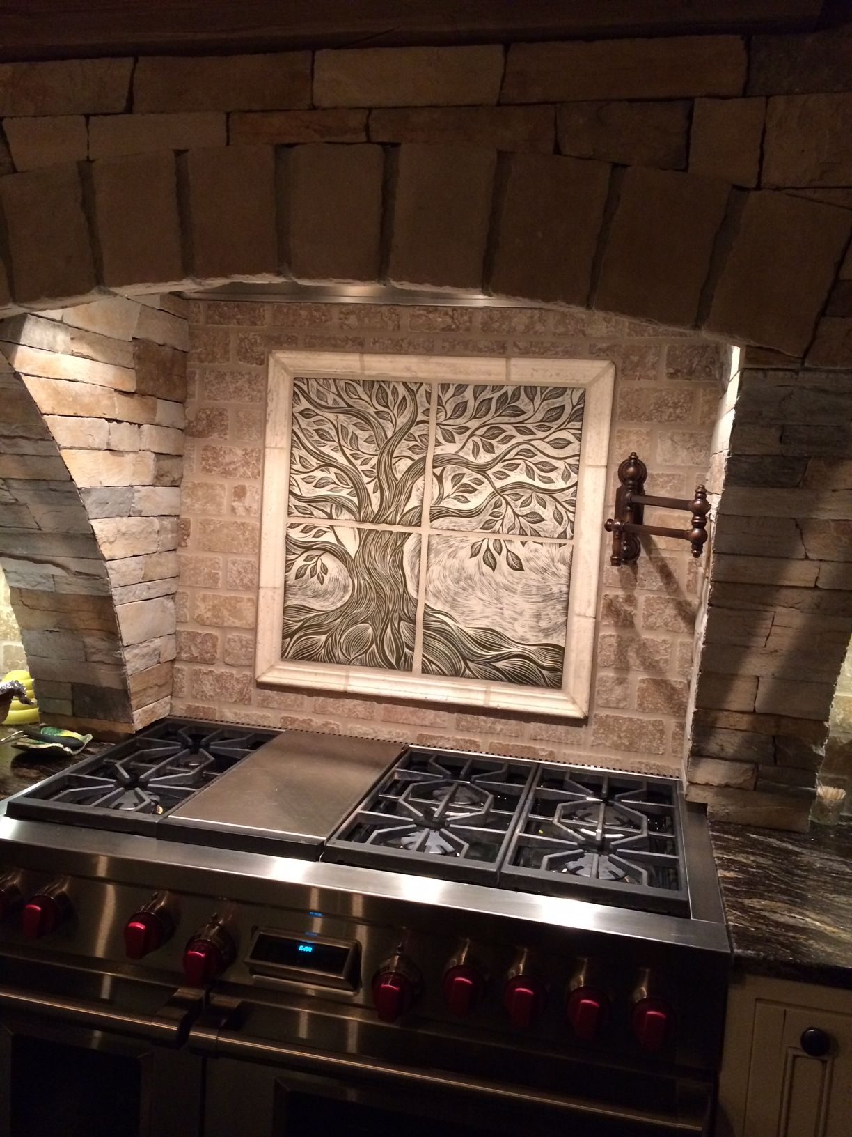 This is a custom 24 x 24 sculptural ceramic backsplash for Custom photo tile mural