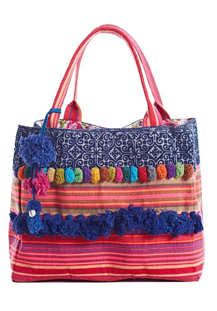 Cool boho style on a classic handmade Thai tote with pompons and Batik print. Bags and cushions are created by the HMONG TRIBE and produced in fair trade. Each bag is one of a kind as parts are made f