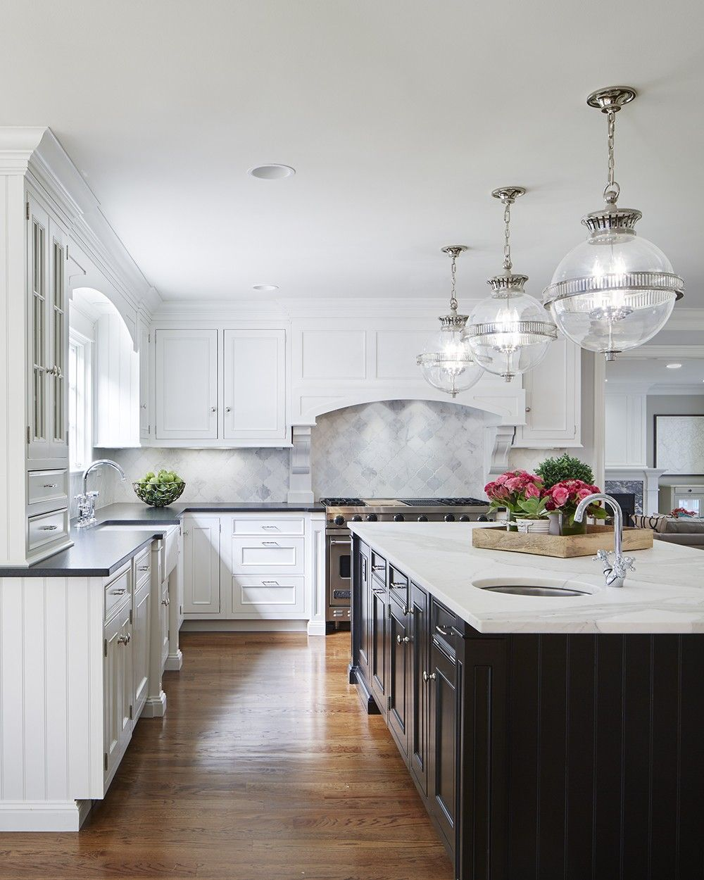 White Kitchen With Dark Island Glass Pendants Martha O
