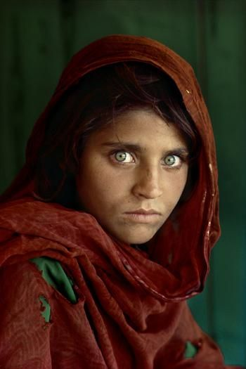 "National Geographic Cover 1985, Afgan Girl, Sharbat Gula, which means ""sweetwater flower girl"" in Pashtu, the language of her Pashtun tribe. Shot by Steve McCurry in a refugee camp on the Pakistan Afghanistan boarder. The mix of bitterness and courage in the 12 year old's eyes came to symbolise the plight and pain and the strength of her people."