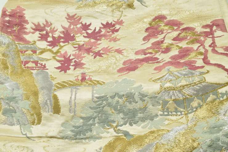 This obi is about 60 years old and features a natural, rural scene.