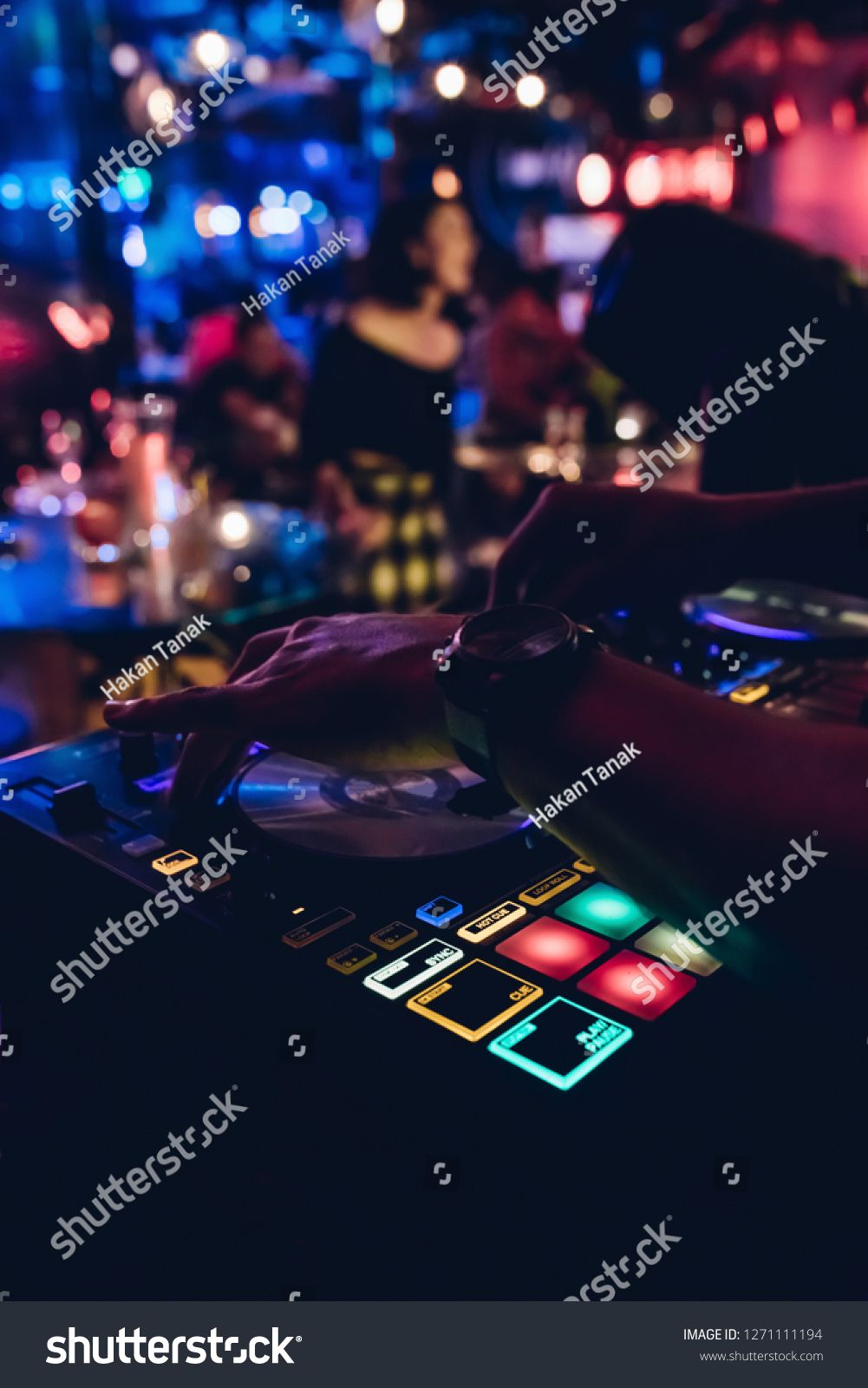 DJ plays live set and mixing music on turntable console at stage in the night club. Disc Jokey Hands on a sound  #Ad , #Affiliate, #console#turntable#stage#club
