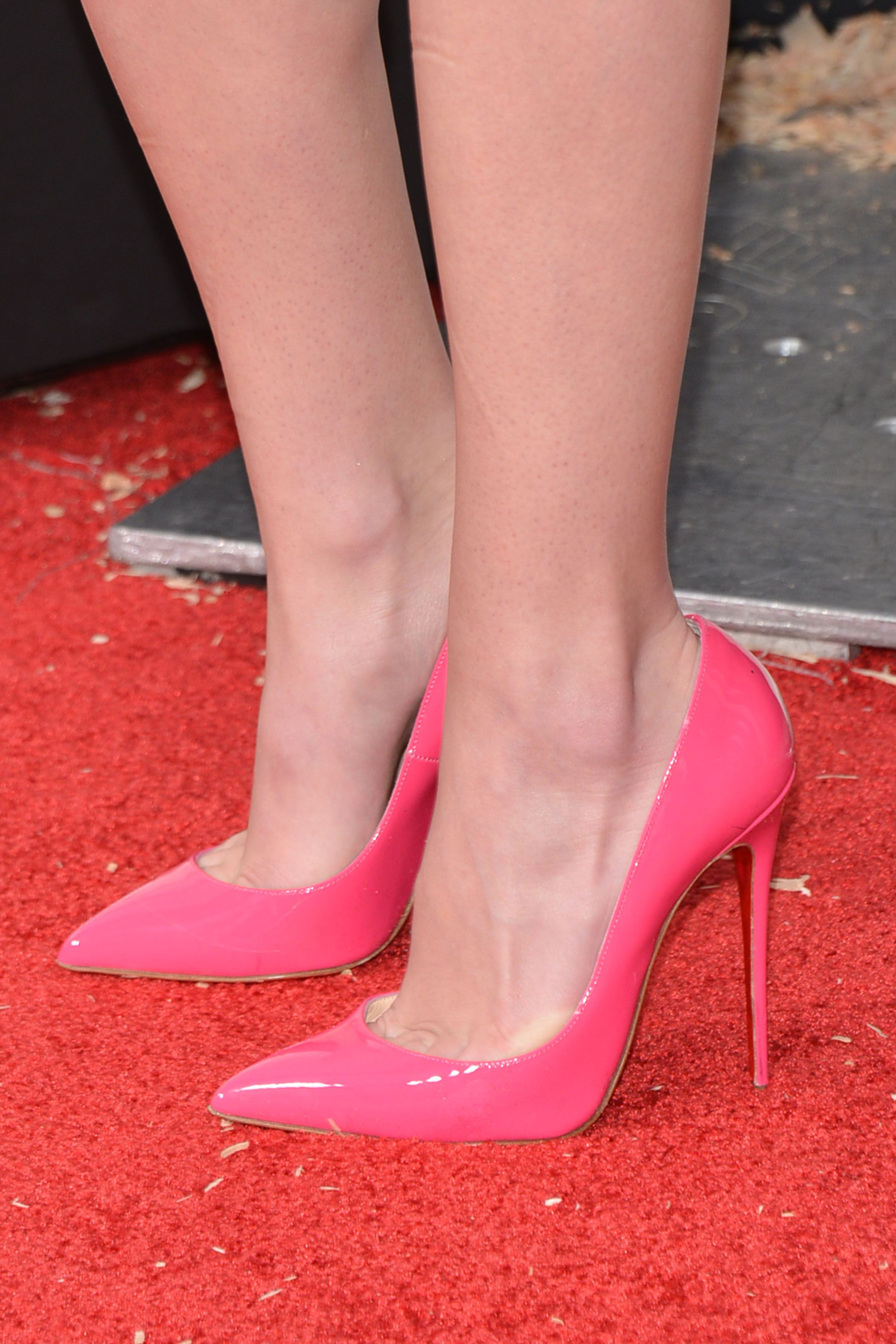 93cc3cb281 louboutins in patent pink on the feet of britt robertson at the ...