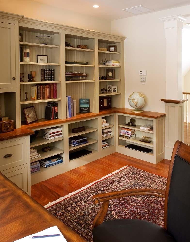 custom office area with open shelving and a solid wood top