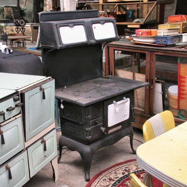 1102: Old cast iron wood cook stove,