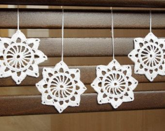Hand crocheted Christmas snowflake ornaments.  The price is for ONE SNOWFLAKE.  The snowflake is crocheted using cotton yarn and starched. The diameter