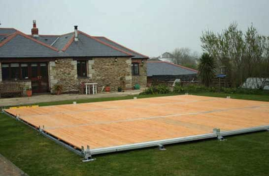 Article about laying box section steel frame marquee flooring (cassette marquee flooring for event tents) with photographs. & Cassette floor installed on top. | Types of marquee flooring ...