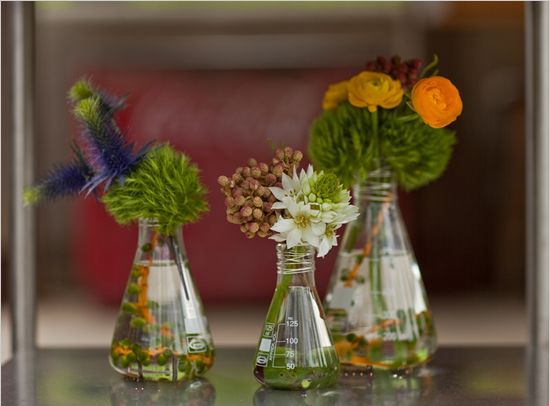 Lovely science-inspired floral arrangements! We have 4 Erlenmeyer flasks in our inventory so you can recreate this look, along with some beakers that would make great votive holders! Check them out at www.momentarilyyours.com.