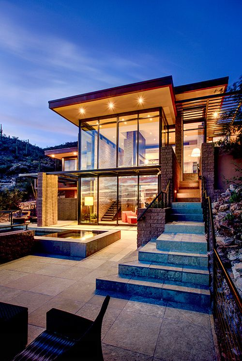 Multi-level desert home organically forms into the mountainside ...