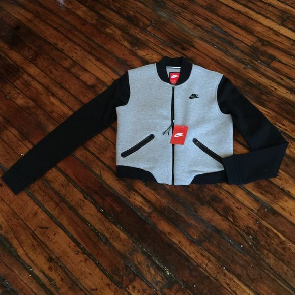 Nike Tech Fleece 3mm bomber This jacket is too cool! Black and grey bomber zip up by Nike. Two zip pockets on front.  Heavy cotton poly blend- the name of the jacket is 'tech fleece' but the jacket has no fuzzy sides. Nike Jackets & Coats