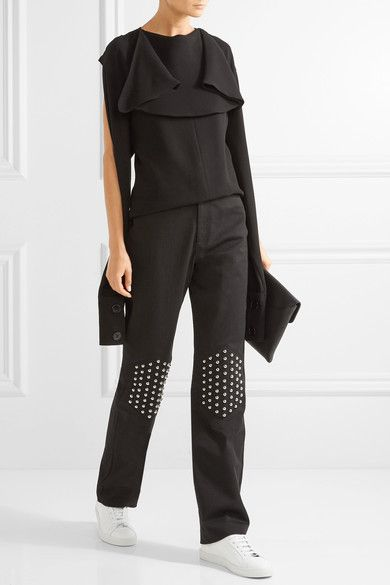 J.W. Anderson studded boyfriend jeans and Common Projects sneakers