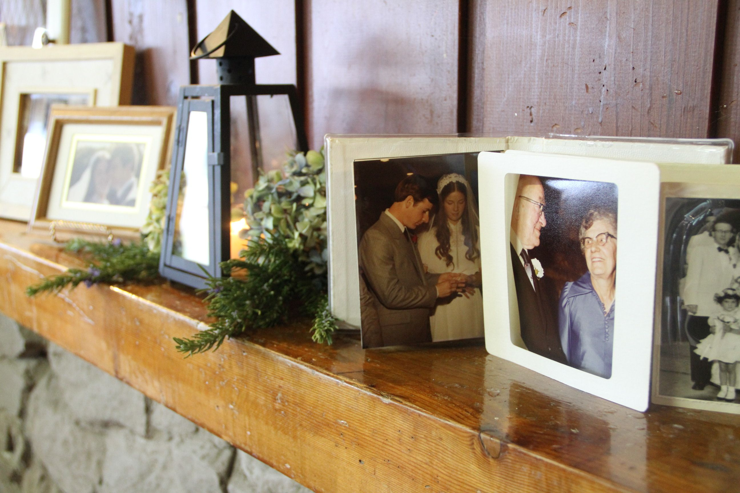A celebration of love. Family wedding photos line the mantle.