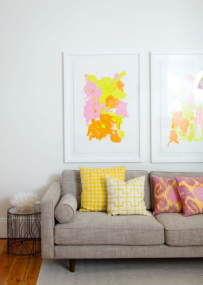 my living room with yellow chevron pillows and Ikat pillows 1950's sofa  Hannah Blackmore