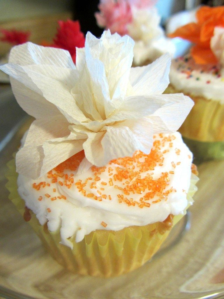 Crepe-paper flower toppers for cupcakes. http://athingcreated.com/2012/04/05/crepe-paper-flower-cupcakes/