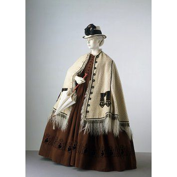 By the 1860s, skirts had reached their fullest point. They were worn over wire 'cage crinolines', which gave maximum volume with minimum wei...