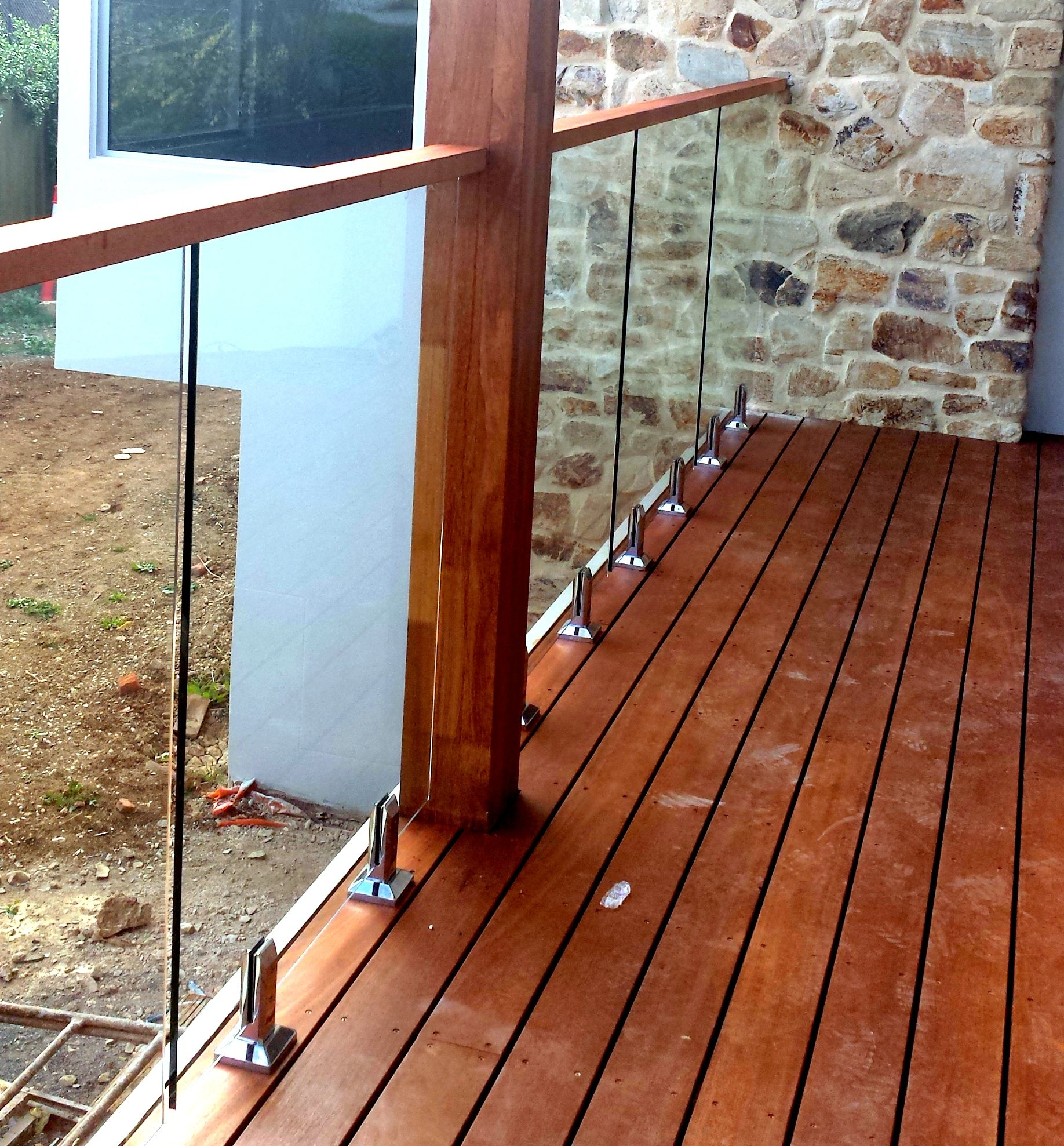 Glass balustrades attached to timber decking with for Timber deck construction