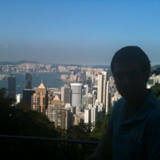 Me on top of the peak overlooking Hong Kong and Kowloon