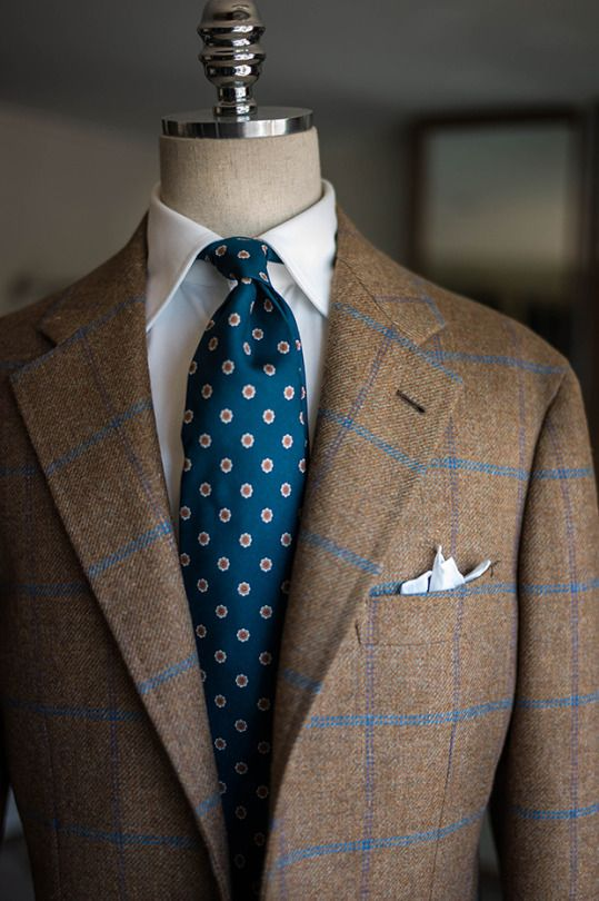 Another example of how to wear a patterned sport coat by B&Tailor. A simple white shirt and blue flower-patterned tie keep the whole ensemble restrained and also draws the attention to that beautiful windowpane pattern of the jacket.