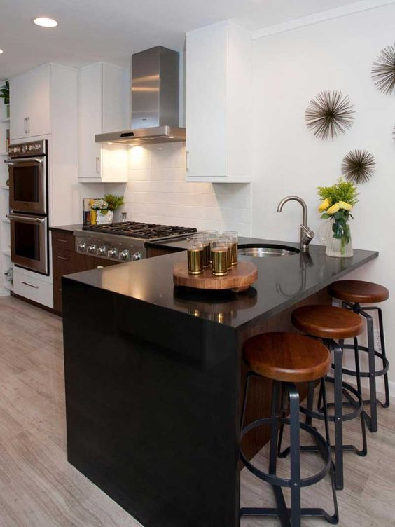 A Sleek Look Effect Is Provided With A Black Quartz Waterfall