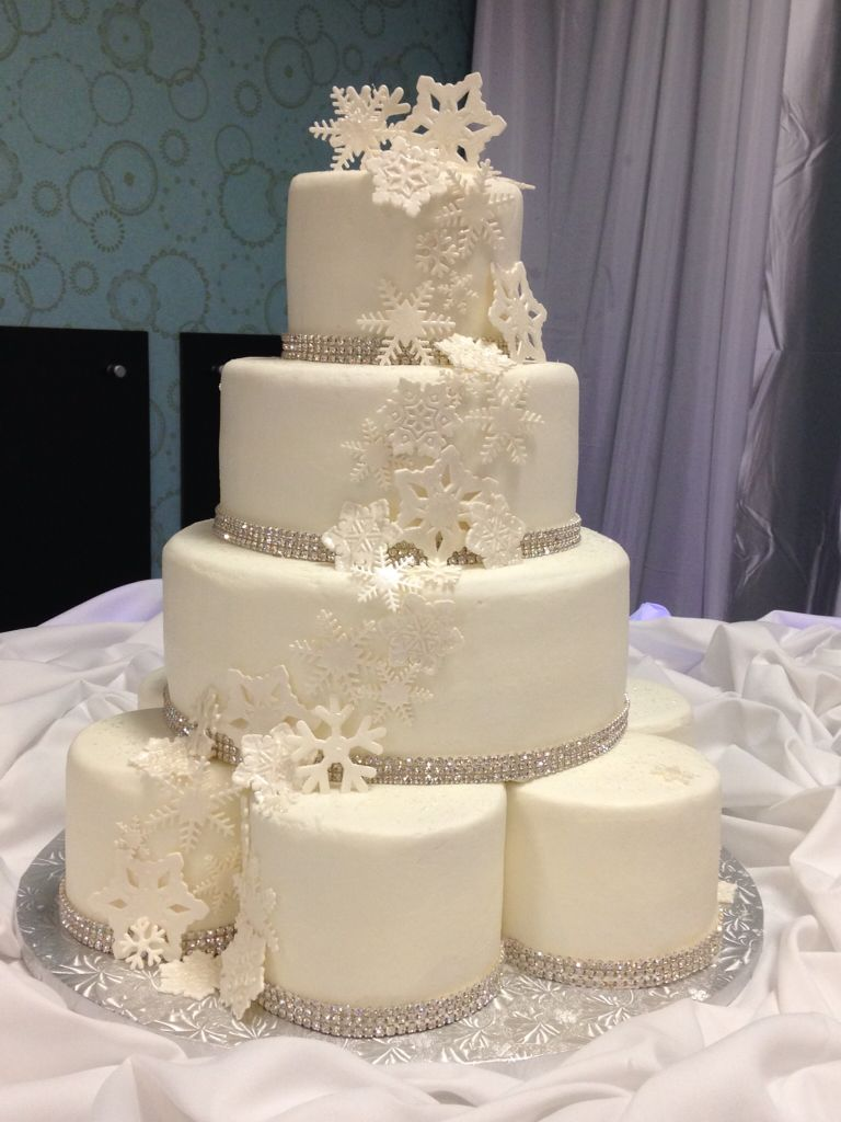 Winter wedding cake with cascading snowflakes and rhinestones. All ...