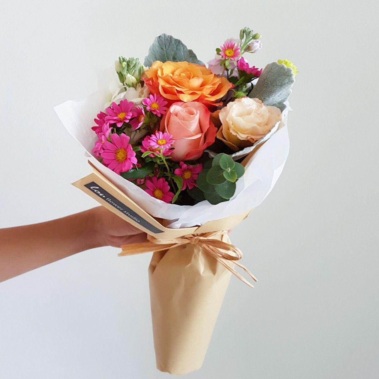 Autumn Hues Make This Posy Of Roses Daisies Eustoma And Matthiola With Silver Leaves Flowers To Go Bouquet Delivery Bouquet Styling