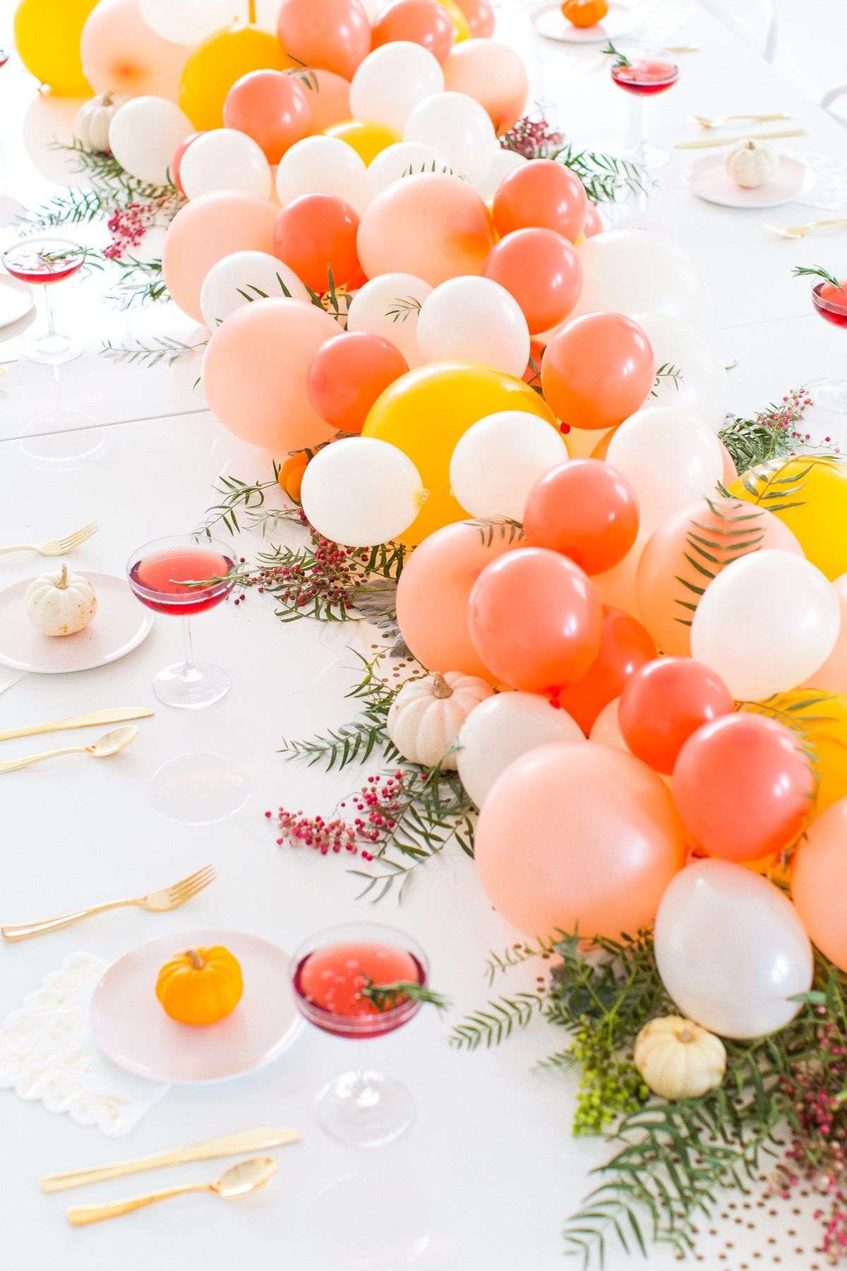 Balloon table runner settings and centerpieces