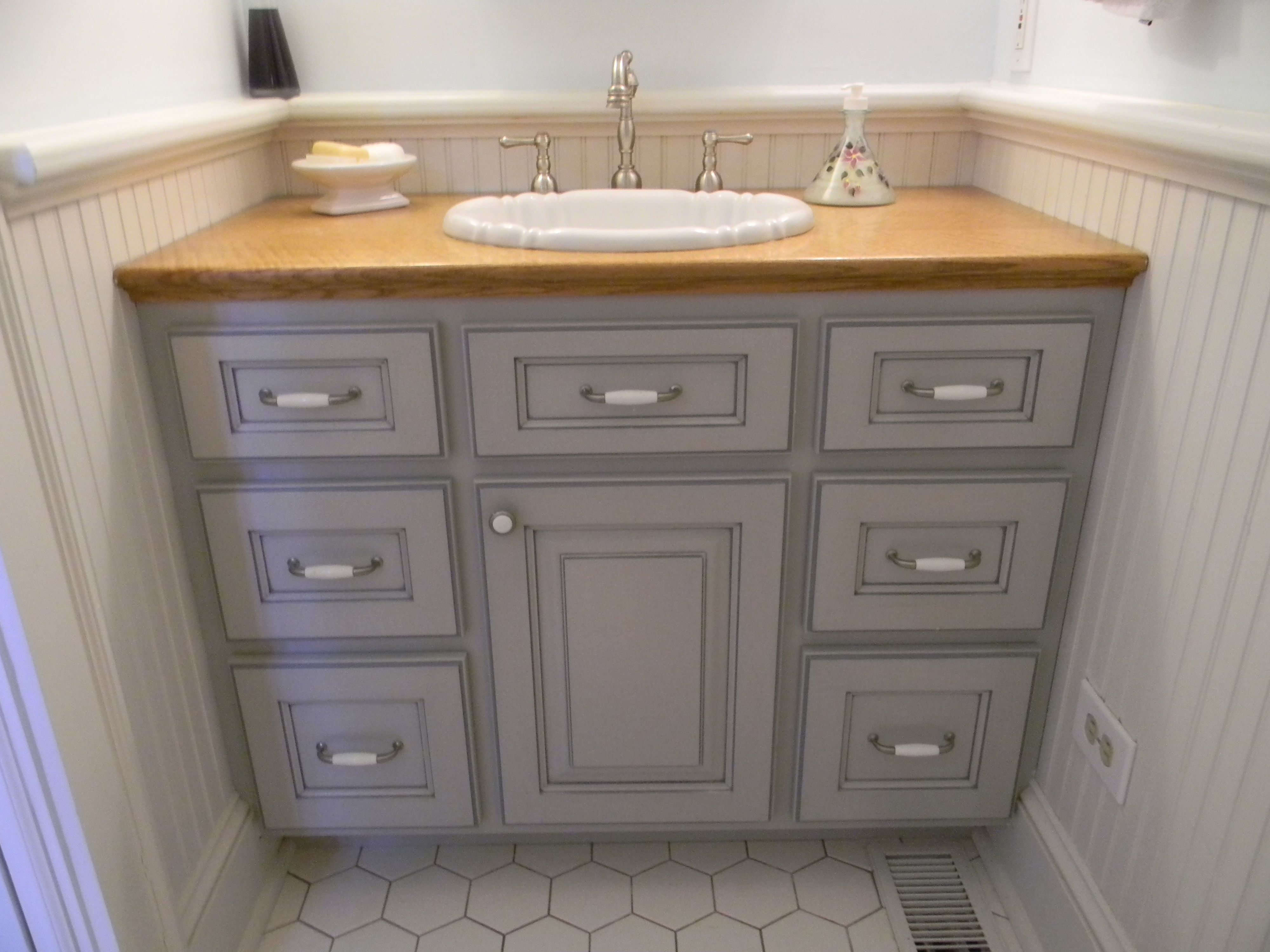 Custom design painted glazed powder room vanity with quartersawn red