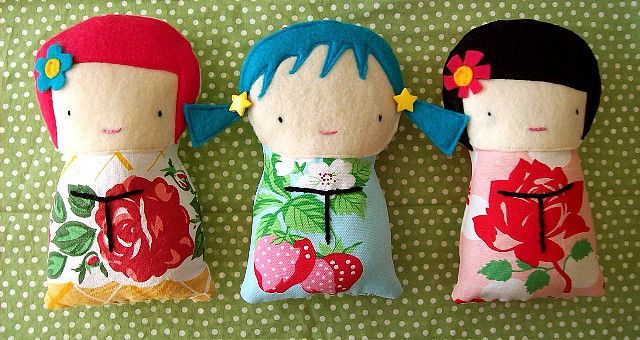 too cute for words. Could applique something similar to quilt block and use buttons for hair ornaments
