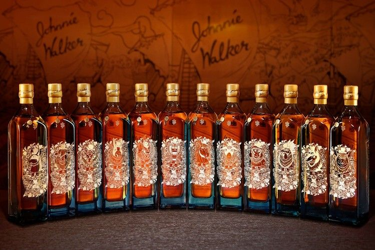 A set of 12 Blue Label whiskeys from Johnnie Walker, each designed with a different