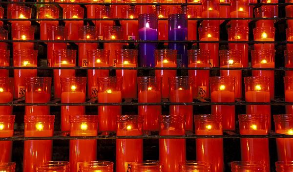 Sea of red candles with two purple candles at Montserrat in Barcelona Spain.