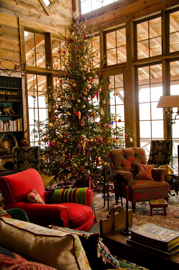 A Big Cabin In The Mountains With A Big Fireplace And Snow Outside - Christmas cabin fireplace scenes