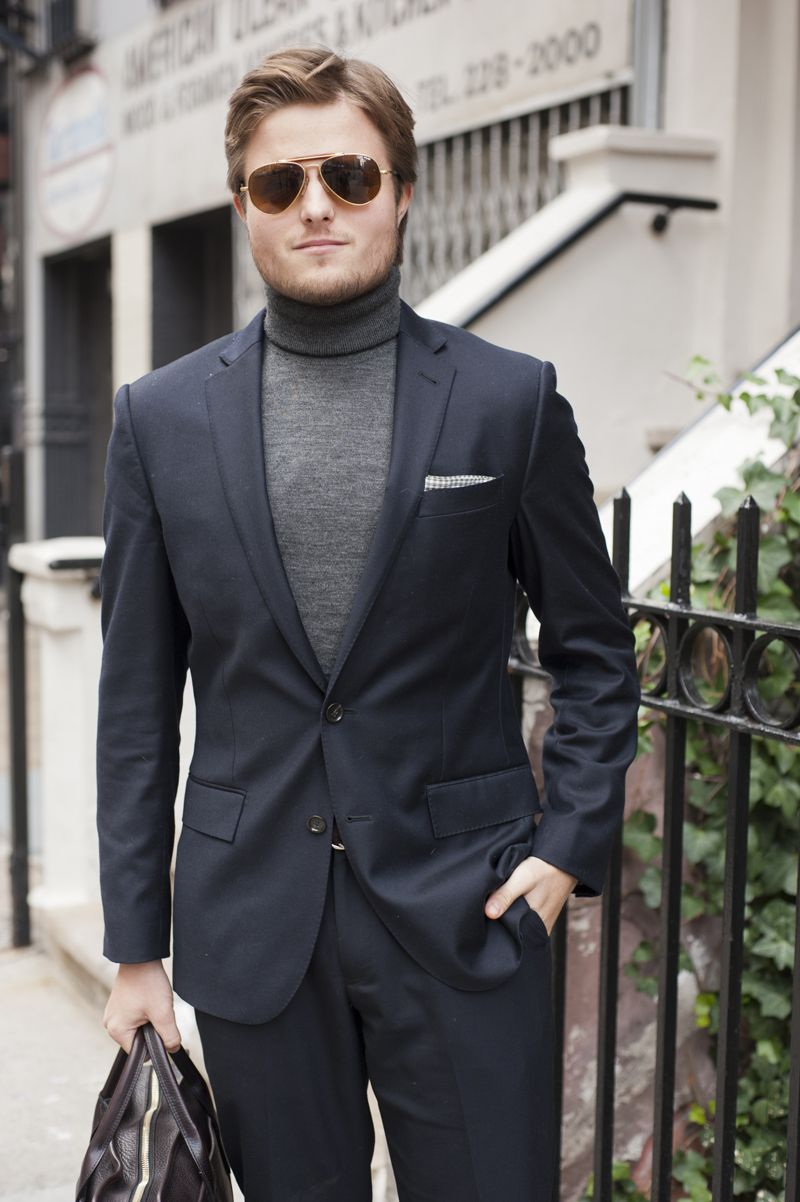 Grey turtle,neck with a navy suit.
