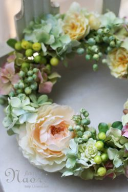 Pretty, but I'm thinking succulents instead of silk flowers