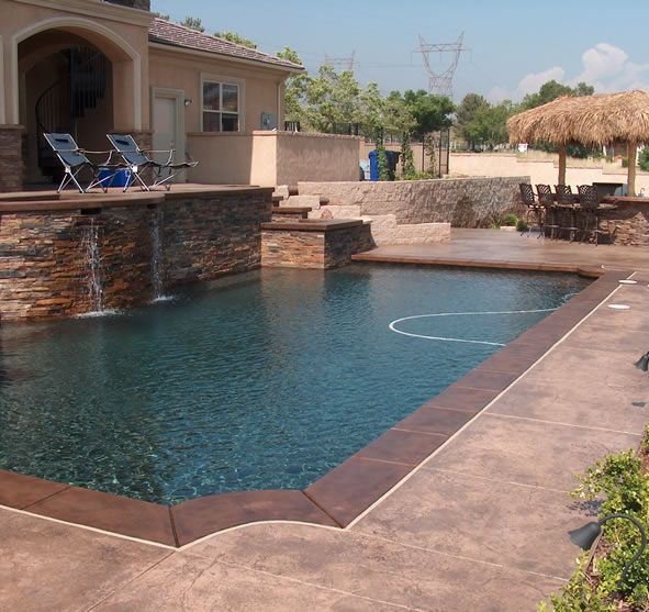 Dark Coping Mid Tone Mottled Stones Pool Decking