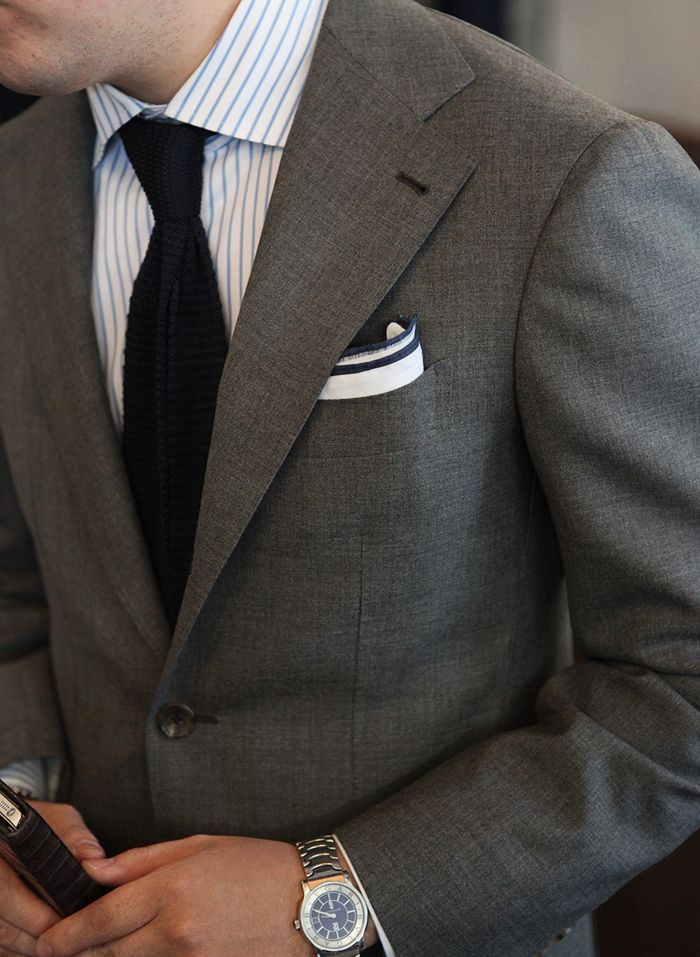 dark grey suit white shirt with blue dress stripes navy