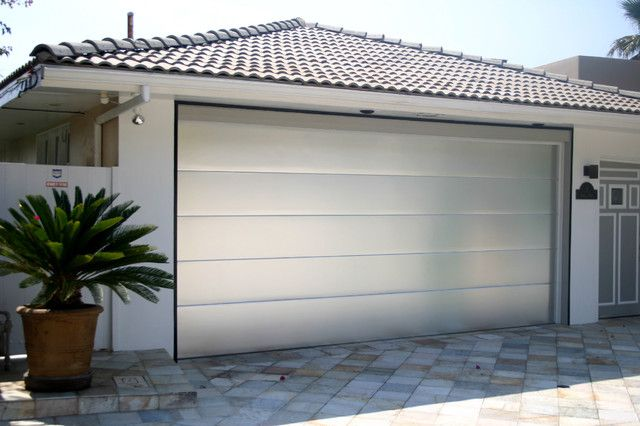 Brushed Aluminium Garage Door Australia With White Rendered Surround And Shallow Pitched Clay Tile Garage Doors Modern Garage Doors Contemporary Garage Doors