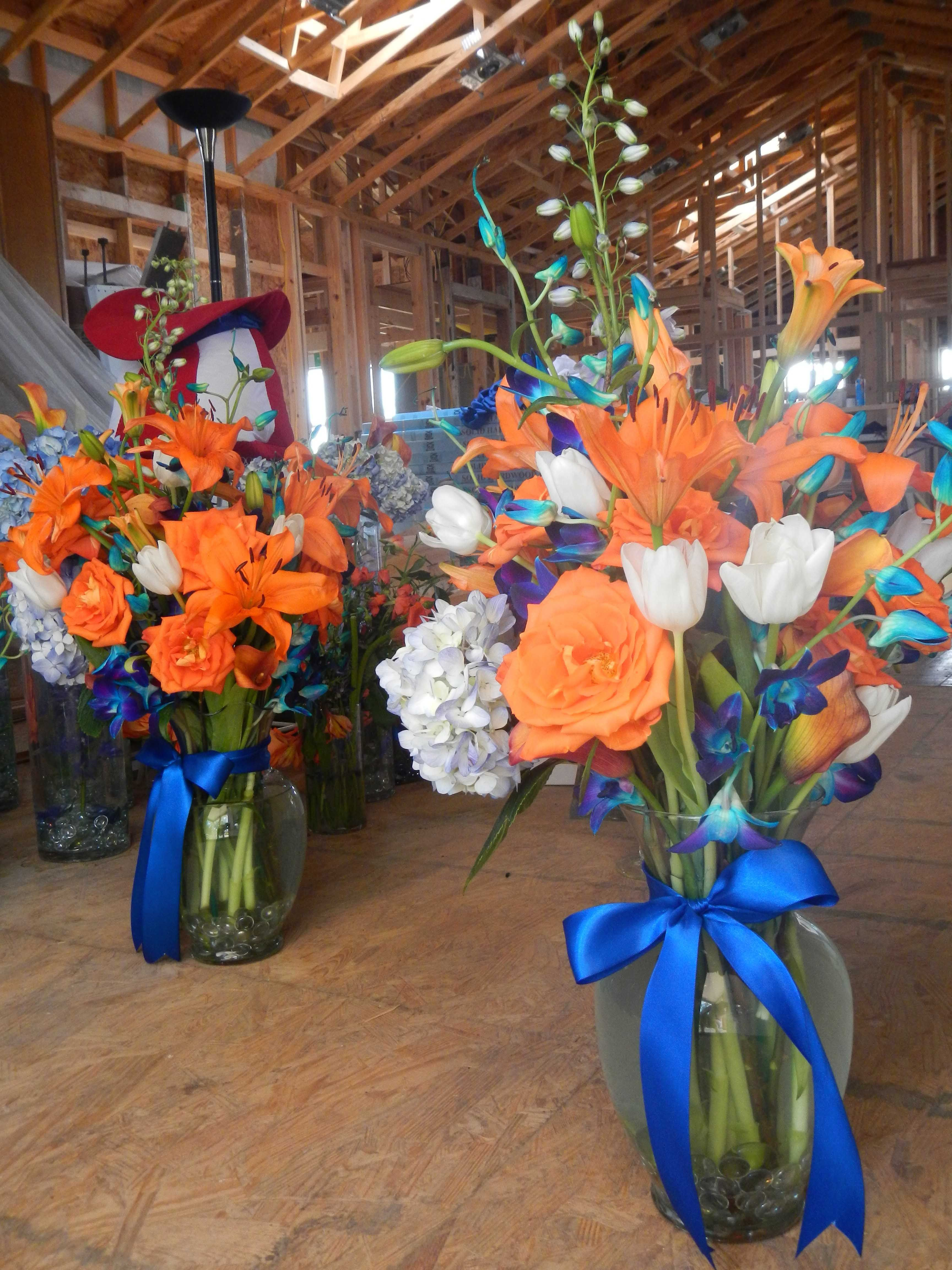 Used to decorate the alter bouquets include orange roses blue