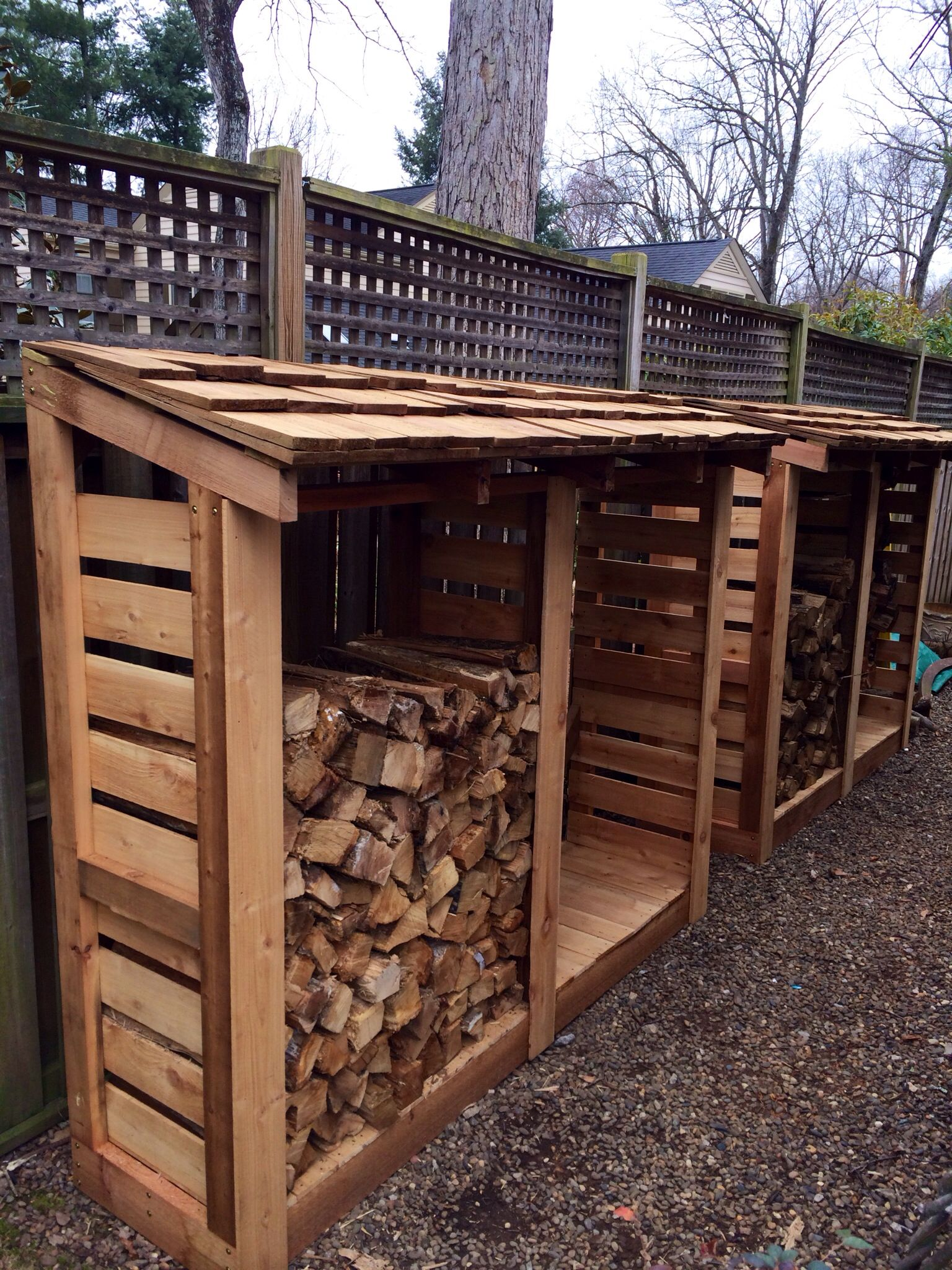 I built these red cedar firewood storage bins for our backyard. I'm so