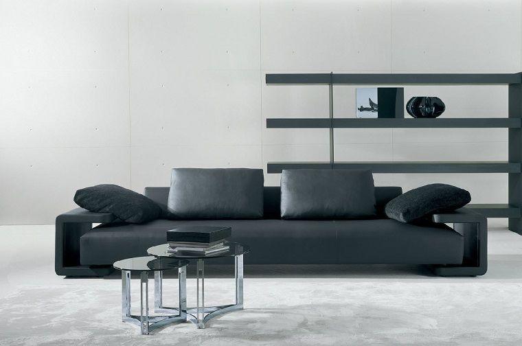 Idea parete attrezzata cartongesso e un divano di pelle nera in un ...