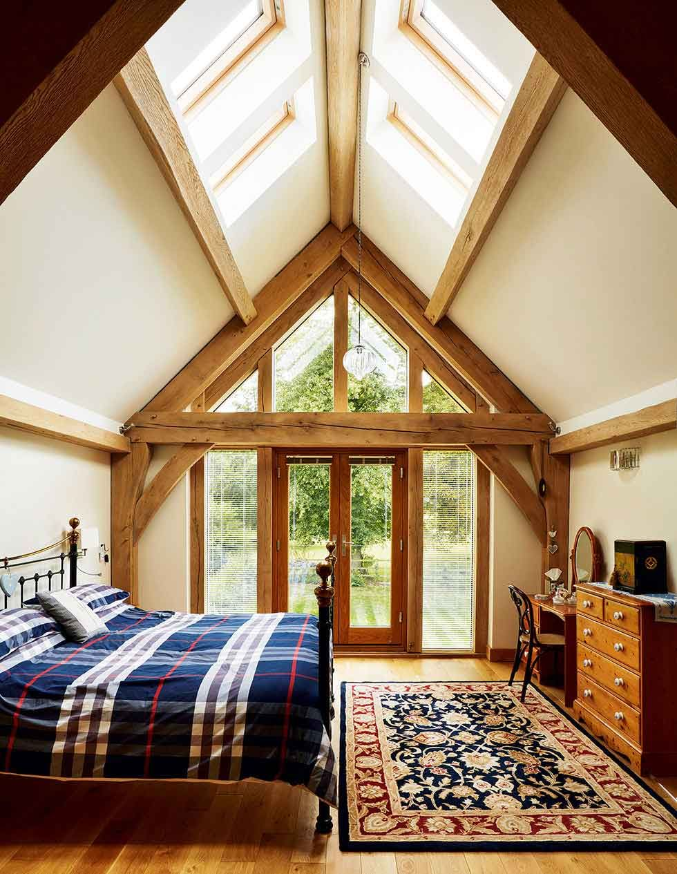 Rooflights in the vaulted ceiling and a glazed gable end ensure this bedroom gets lots of Master bedroom lighting ideas vaulted ceiling