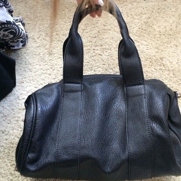 Black purse w gold studs Black purse with gold studs on the bottom, can be worn as a shoulder bag or hand bag with straps for both! Good condition, just been sitting in my closet for a year or 2. Wore it a couple times back then Bags