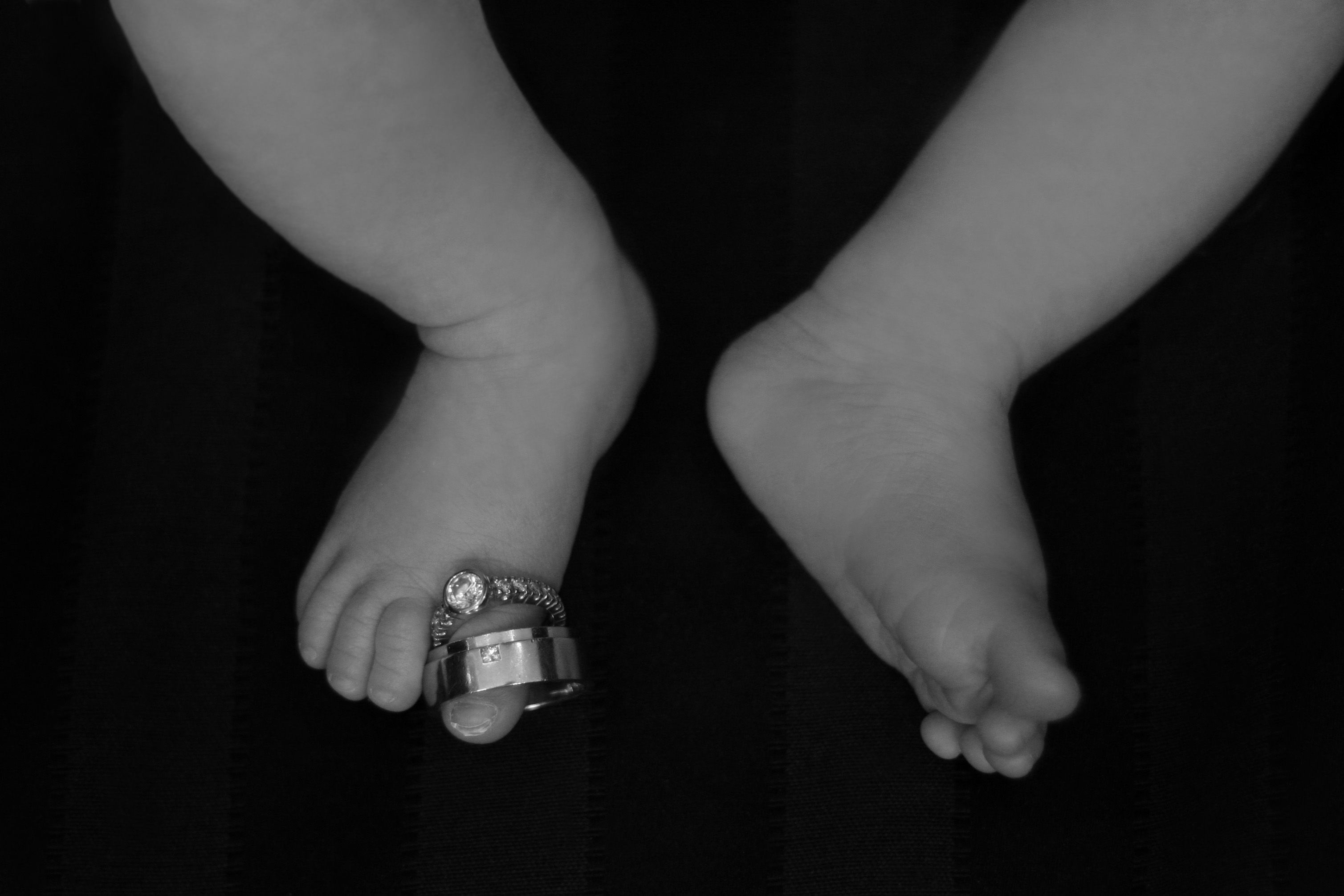 My son's feet with our wedding rings.