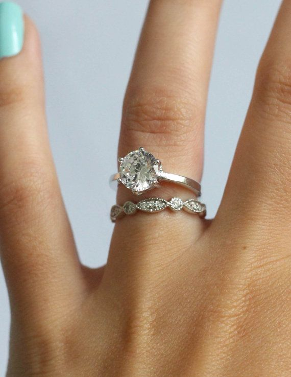Simple solitaire engagement ring with stunning vintage band Love