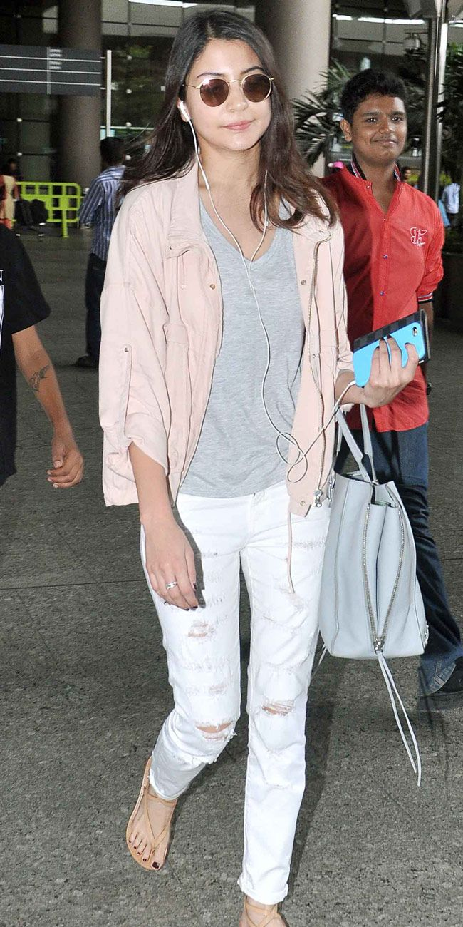 Anushka Sharma in ripped jeans at the Mumbai airport while ...
