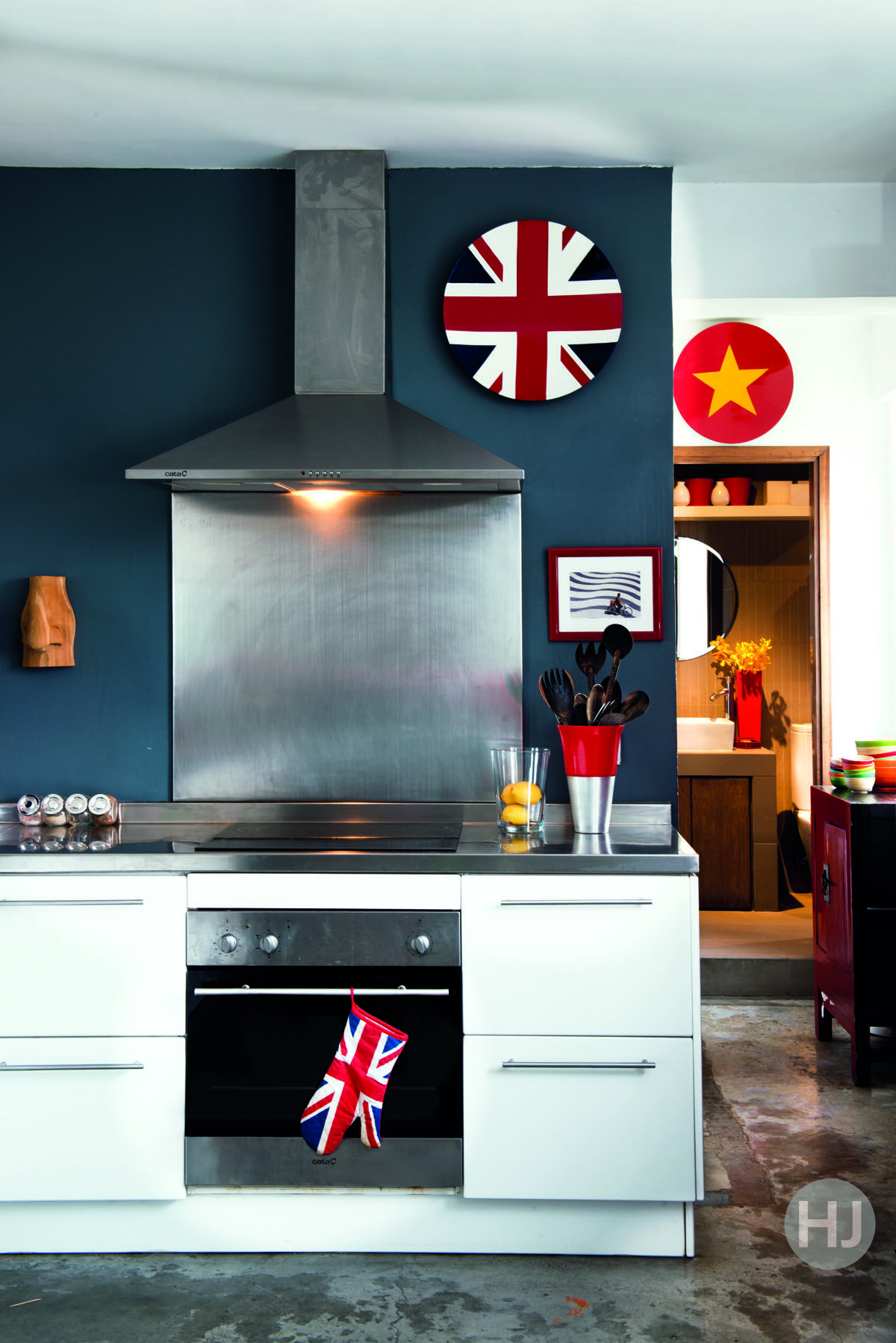 This kitchen is painted with pride to represent the family's proud british heritage in petrol blue, white and fire engine red. Home Journal, February 2015