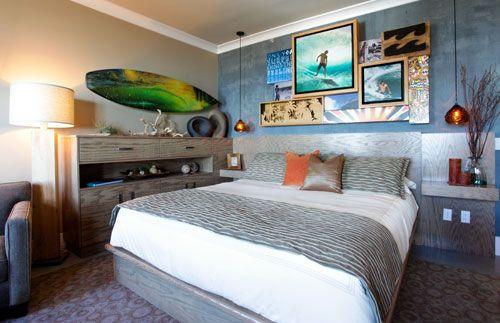 i like the surfboard hanging on the wall... haha i just like the whole room!