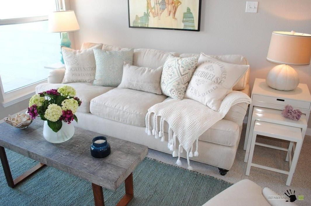 Comfort White Sofa With Small Pillows And Blanket In A